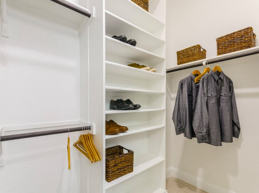 Landon Homes new home builder 432 Carrington Master Closet walk-in with white paint and shoe shelf