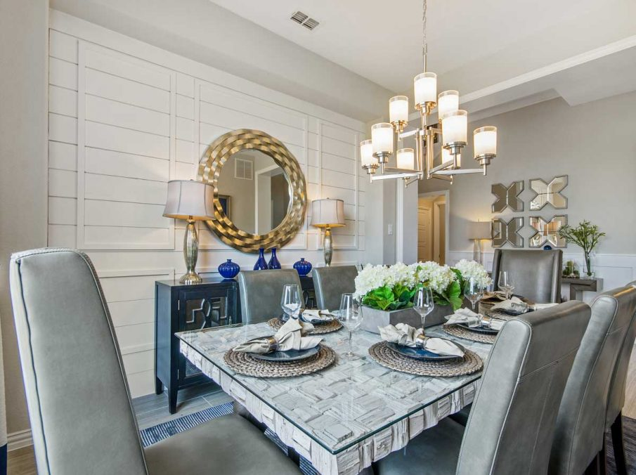 4655 Wellington Landon Homes Decorated Formal Dining with Chandelier and Ship-lap Wall Accent