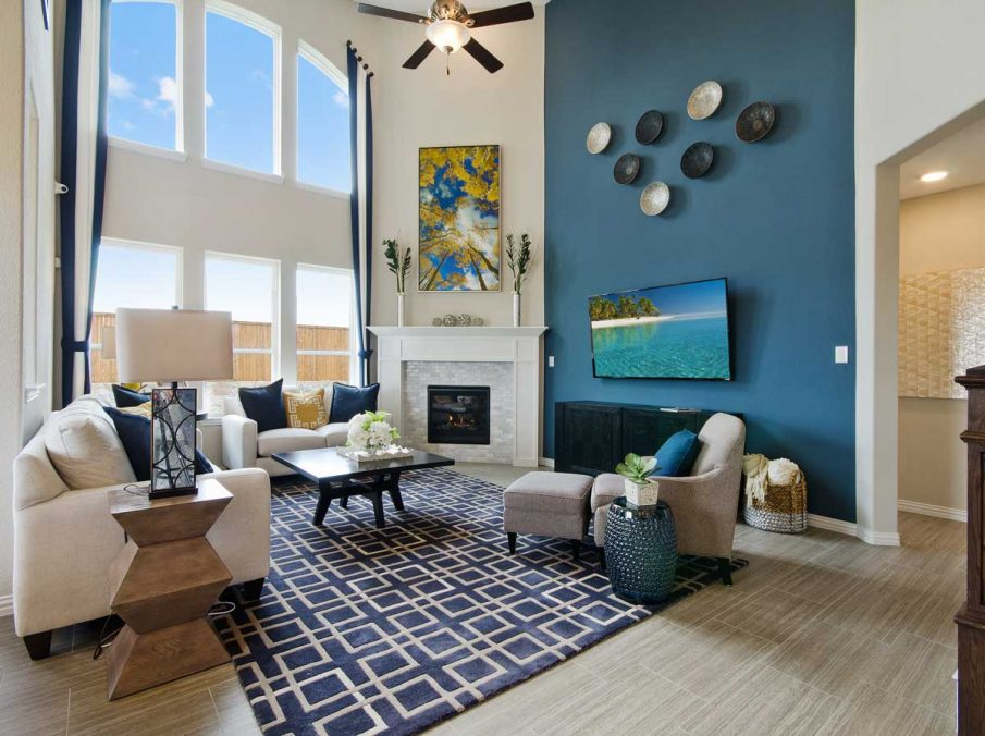 4655 Wellington Landon Homes Decorated Family Room Dark Blue Accent Wall